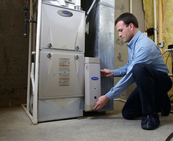 Routine furnace maintenance performed by an HVAC technician