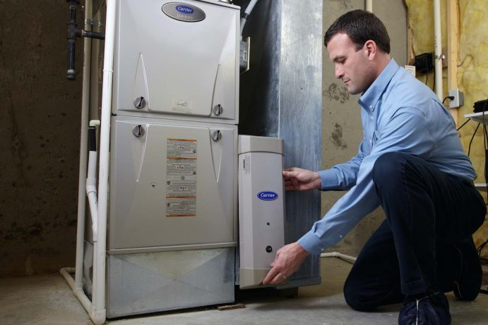 Jacobs technician installing a Carrier furnace