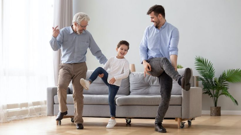 Son Father and grandfather playing in living room