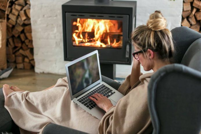 woman sitting by gas fireplace insert